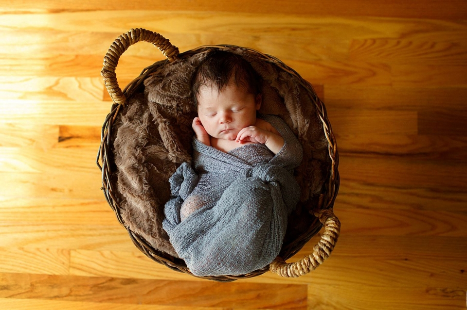 dayton newborn photographer captures baby in basket