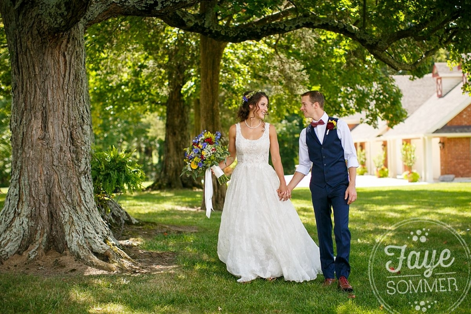 Bride and groom walk at Dayton Ohio wedding