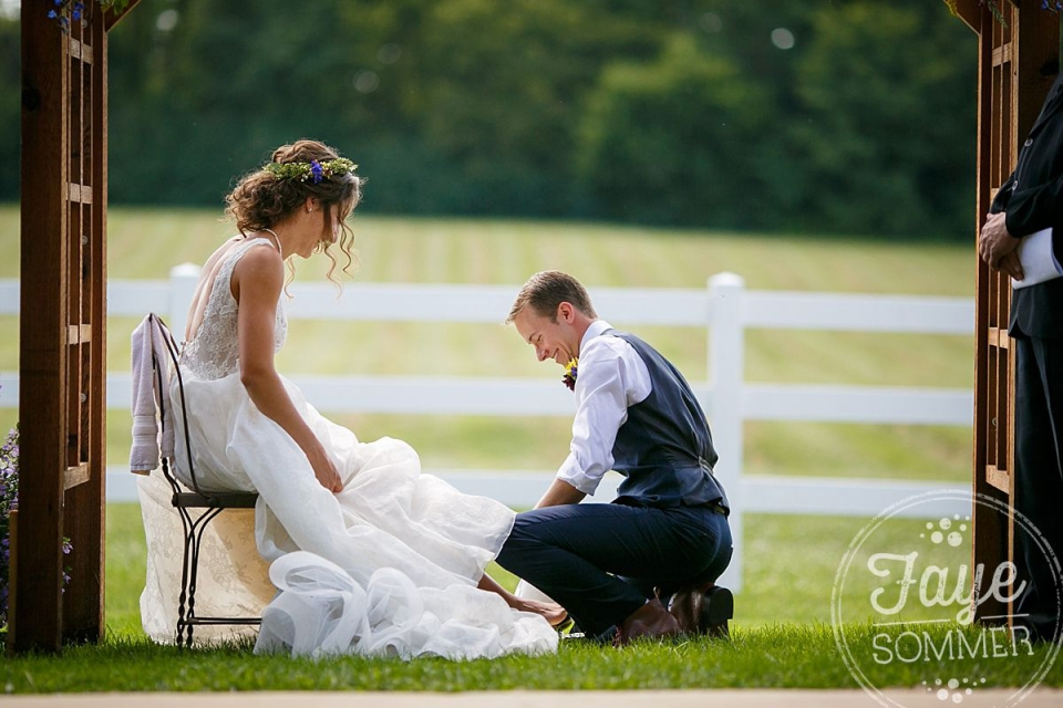 Bride and groom wash feet at Dayton Wedding Ceremony
